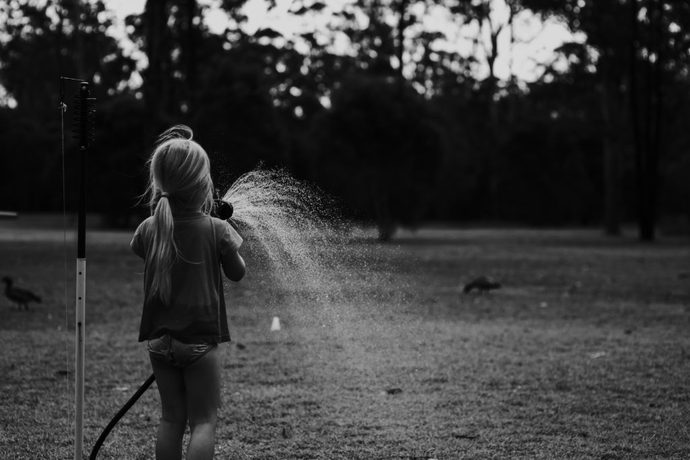 Girl playing with water