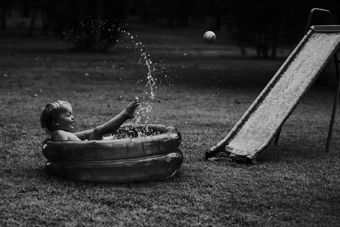 boy in paddle pool